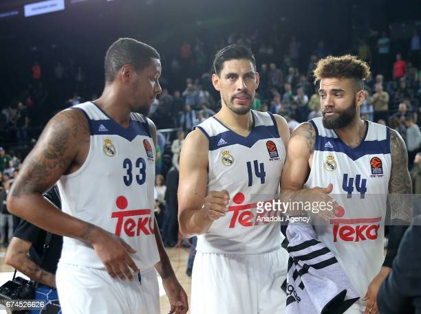Trey Thompkins Gustavo Ayon and Jeffery Taylor of Real Madrid celebrate their victory after the Turkish Airlines EuroLeague Playoffs Game 4 between...