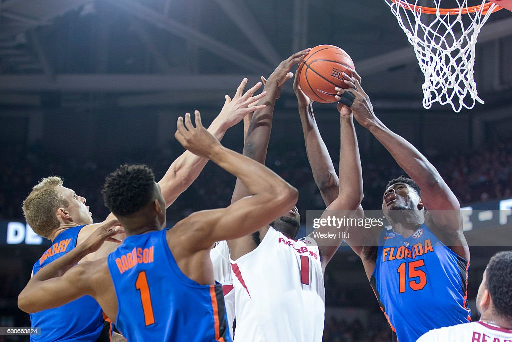 Trey Thompson #1 of the Arkansas Razorbacks goes to the basket and is challenged by John Egbunu #15 of the Florida Gators at Bud Walton Arena on December 29, 2016 in Fayetteville, Arkansas. The Gators defeated the Razorbacks 81-72.