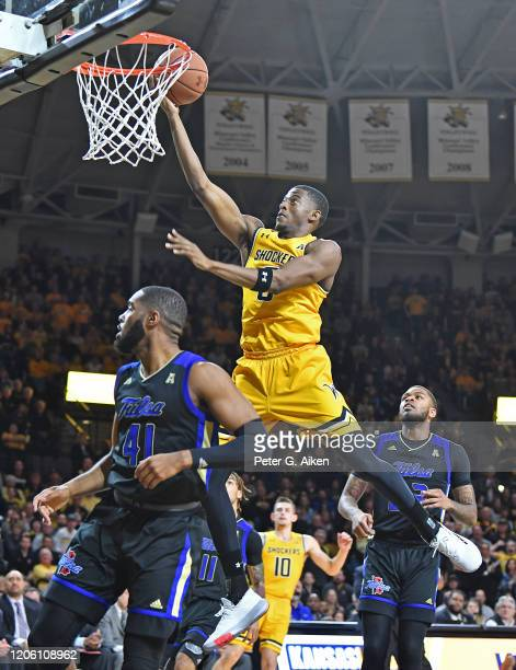 Trey Wade of the Wichita State Shockers drives in for a basket against the Tulsa Golden Hurricane during the first half at Charles Koch Arena on...