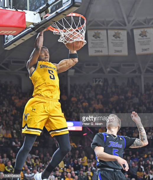 Trey Wade of the Wichita State Shockers dunks the ball against Lawson Korita of the Tulsa Golden Hurricane during the first half at Charles Koch...