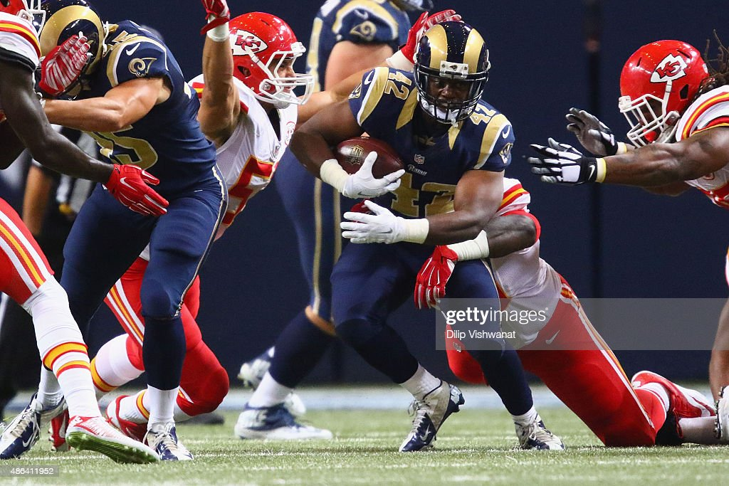 Trey Watts #42 of the St. Louis Rams carries the ball against the Kansas City Chiefs in the third quarter during a pre-season game at the Edward Jones Dome on September 3, 2014 in St. Louis, Missouri.