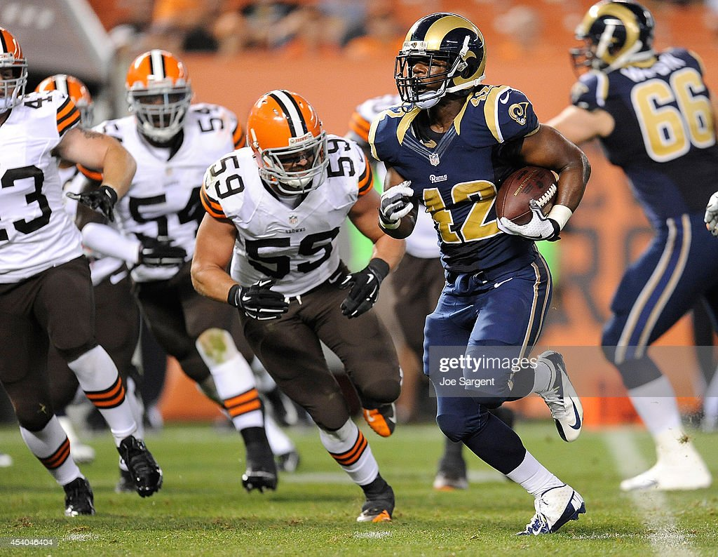 Trey Watts #42 of the St. Louis Rams runs for a touchdown in front of Tank Carder #59 of the Cleveland Browns at FirstEnergy Stadium on August 23, 2014 in Cleveland, Ohio.