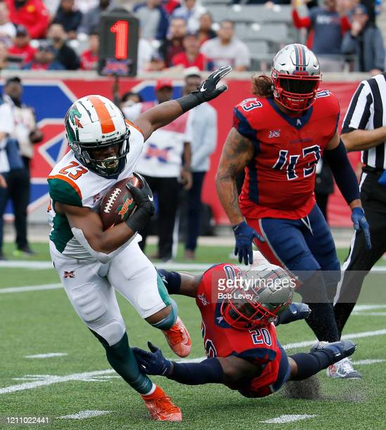 Trey Williams of the Seattle Dragons scores a touchdown in the second quarter as he breaks the tackle attempt by Marqueston Huff of the Houston...