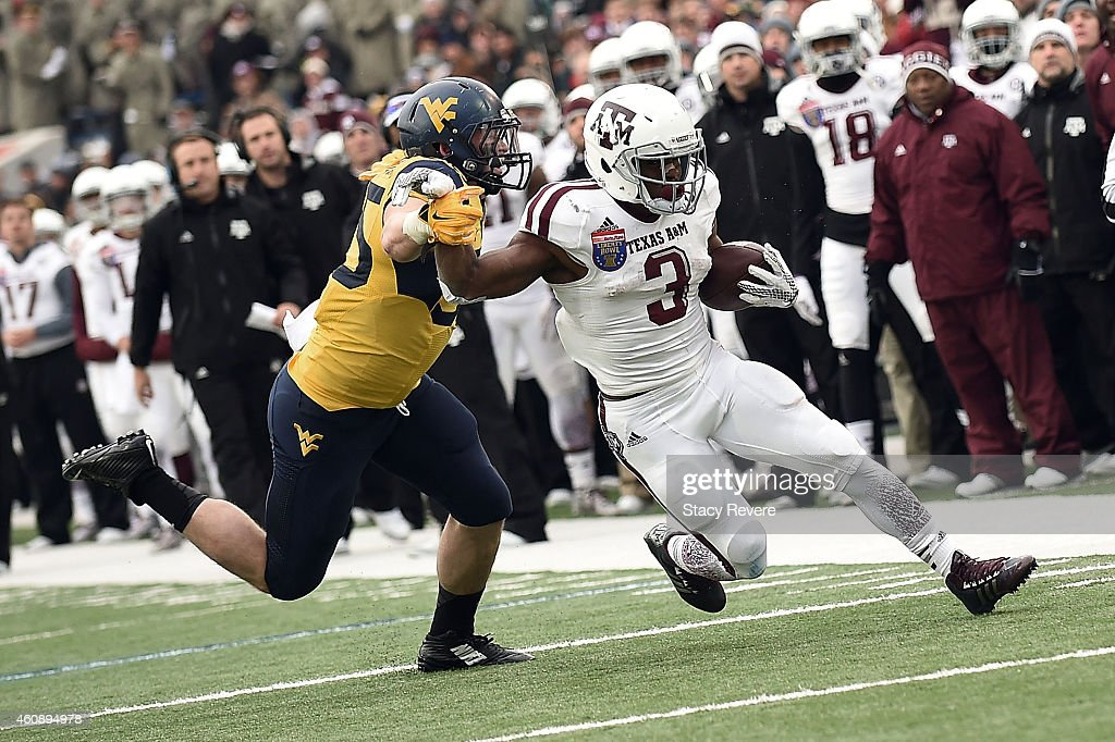 Trey Williams #3 of the Texas A&M Aggies avoids a tackle by Nick Kwiatkoski #35 of the West Virginia Mountaineers during the third quarter of the 56th annual Autozone Liberty Bowl at Liberty Bowl Memorial Stadium on December 29, 2014 in Memphis, Tennessee.