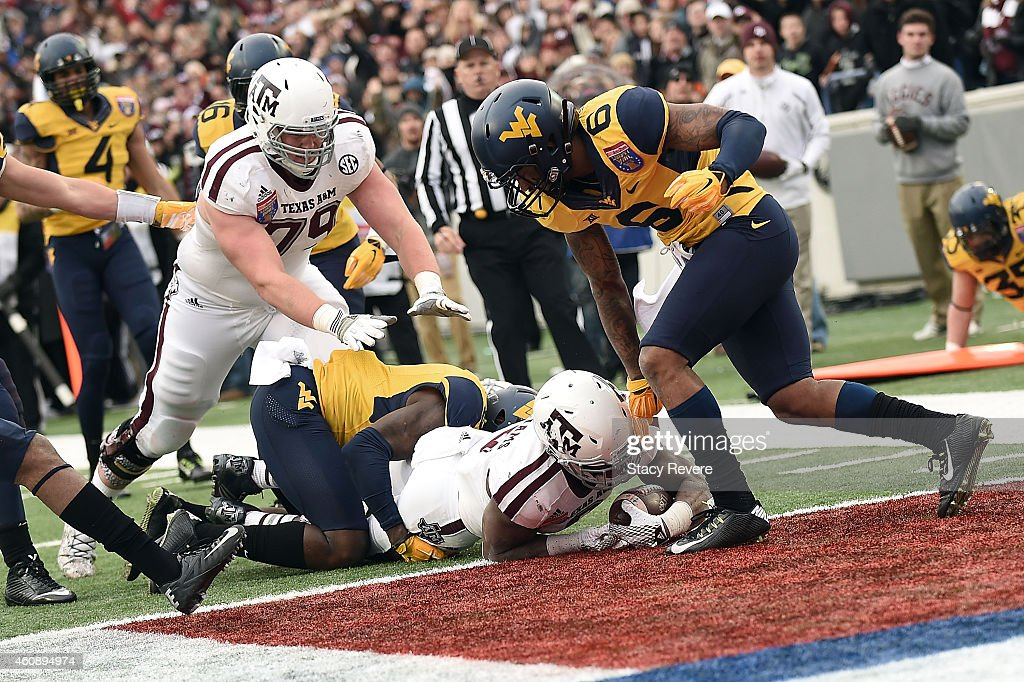 Trey Williams #3 of the Texas A&M Aggies scores a touchdown against the West Virginia Mountaineers during the third quarter of the 56th annual Autozone Liberty Bowl at Liberty Bowl Memorial Stadium on December 29, 2014 in Memphis, Tennessee.