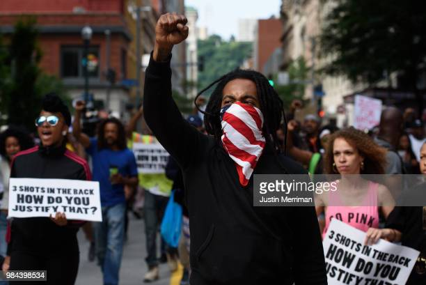 Trey Willis of Washington Pennsylvania marches during a protest a day after the funeral for Antwon Rose II on June 26 2018 in downtown Pittsburgh...