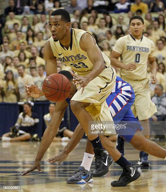 Trey Zeigler of the Pittsburgh Panthers handles the ball against the DePaul Blue Demons at Petersen Events Center on January 26, 2013 in Pittsburgh,...