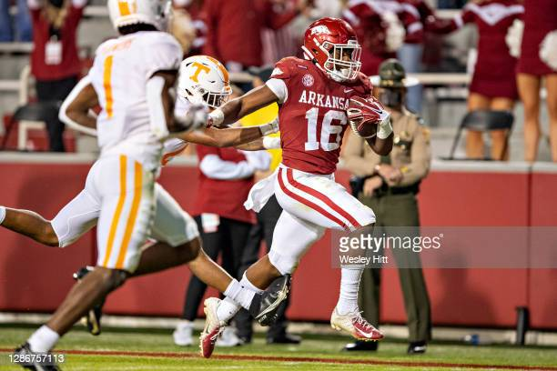 Treylon Burks of the Arkansas Razorbacks runs a pass in for a touchdown during a game against the Tennessee Volunteers at Razorback Stadium on...