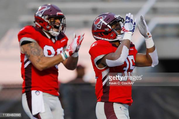 TreyWilliams of the San Antonio Commanders celebrates after rushing for a 12-yard touchdown during the third quarter against the Birmingham Iron in...