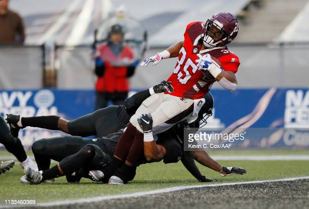 TreyWilliams of the San Antonio Commanders rushes for a 12yard touchdown during the third quarter against the Birmingham Iron in an Alliance of...