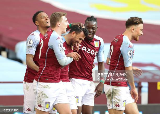 Trezeguet is congratulated by his Aston Villa colleagues after scoring his second goal during the Premier League match between Aston Villa and Fulham...