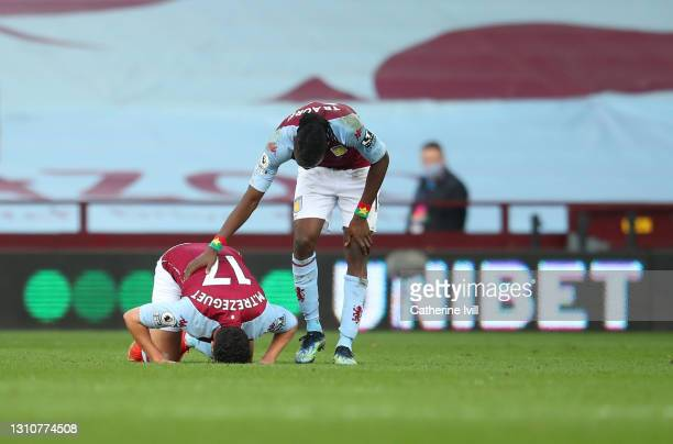Trezeguet of Aston Villa celebrates with team mate Bertrand Traore of Aston Villa after scoring their side's first goal during the Premier League...