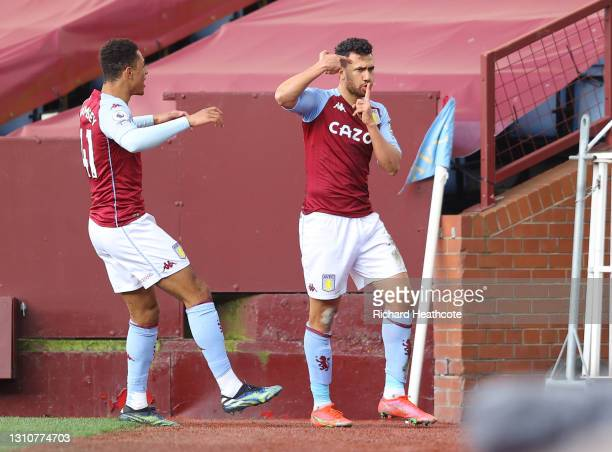 Trezeguet of Aston Villa celebrates with team mate Jacob Ramsey after scoring their side's second goal during the Premier League match between Aston...