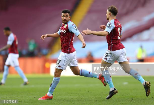 Trezeguet of Aston Villa celebrates with team mate Matty Cash after scoring their side's first goal during the Premier League match between Aston...