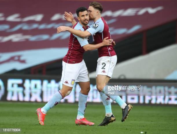 Trezeguet of Aston Villa celebrates with team mate Matty Cash after scoring their side's second goal during the Premier League match between Aston...