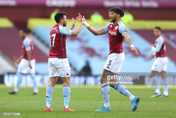 Trezeguet of Aston Villa celebrates with team mate Tyrone Mings after scoring their side's first goal during the Premier League match between Aston...