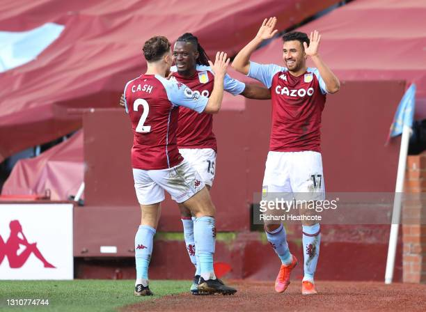 Trezeguet of Aston Villa celebrates with team mates Matty Cash and Bertrand Traore after scoring their side's second goal during the Premier League...