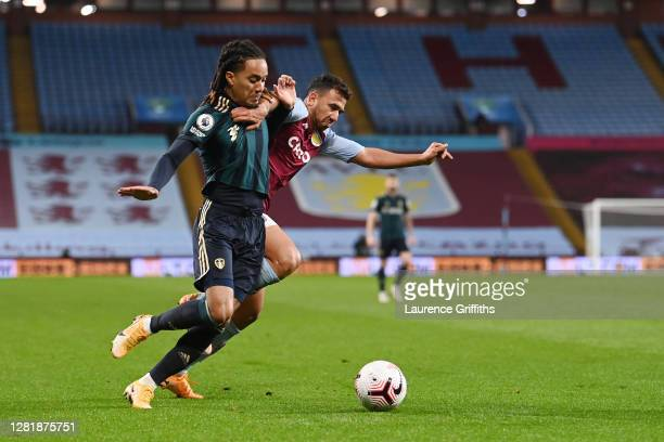 Trezeguet of Aston Villa holds off Helder Costa of Leeds United during the Premier League match between Aston Villa and Leeds United at Villa Park on...