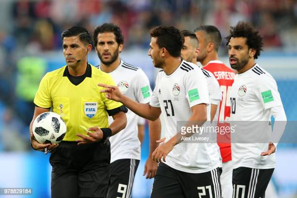 Trezeguet of Egypt argues with Referee Enrique Caceres during the 2018 FIFA World Cup Russia group A match between Russia and Egypt at Saint...