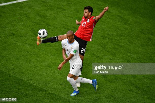 Trezeguet of Egypt challenge for the ball with Carlos Sanchez of Uruguay during the 2018 FIFA World Cup Russia group A match between Egypt and...