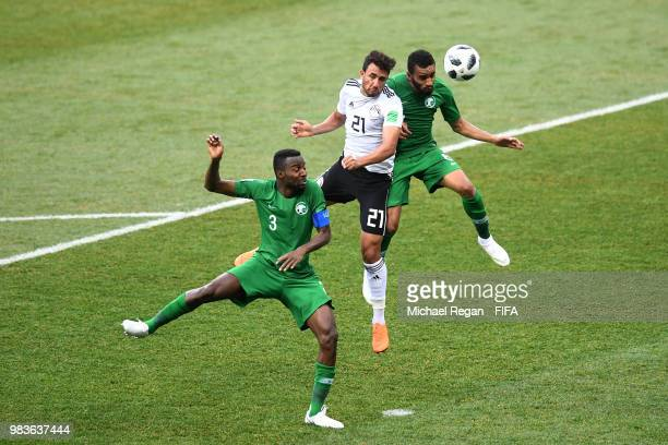 Trezeguet of Egypt competes for a header with Mohammed Alburayk of Saudi Arabia during the 2018 FIFA World Cup Russia group A match between Saudia...