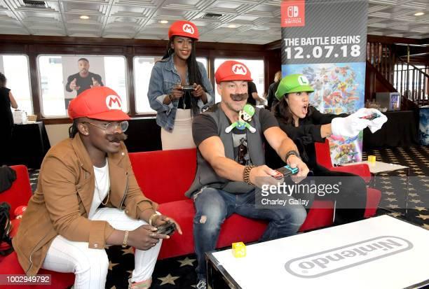 Trezzo Mahoro Rukiya Bernard Aleks Paunovic and Jennifer Cheon put their gaming skills to the test playing Mario Kart 8 Deluxe on Nintendo Switch at...