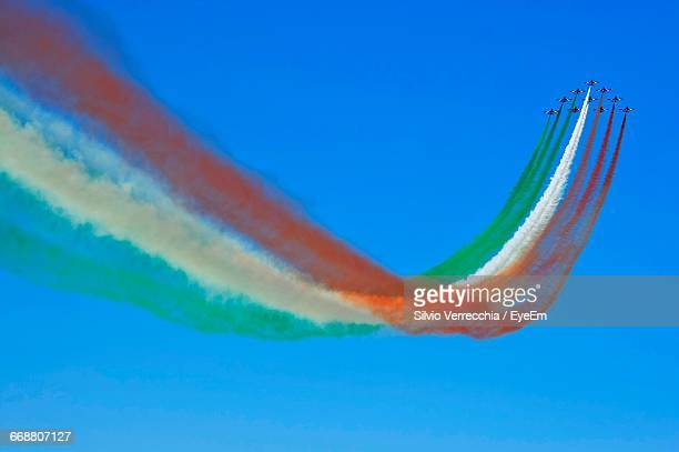 tri color vapor trails during air show - indian flag stock pictures, royalty-free photos & images