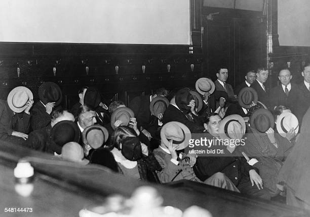 Trial against Al Capone; the spectators are covering their faces with hats in order to remain unrecognized - October 1931, Chicago Federal Building -...