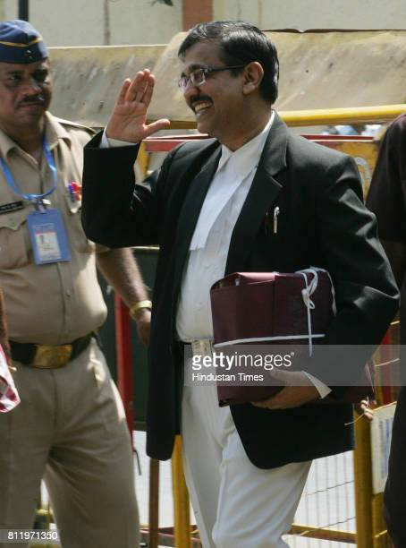Trial Public Prosecutor Ujjwal Nikam salutes the police security posted outside Arthur Road Jail in Mumbai on the first day of the sensational trial...