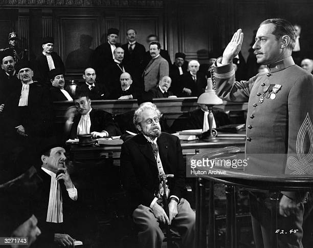 A trial scene from the film 'The Life Of Emile Zola' the story of the French writer who intervened in the famous case of Alfred Dreyfus a French...