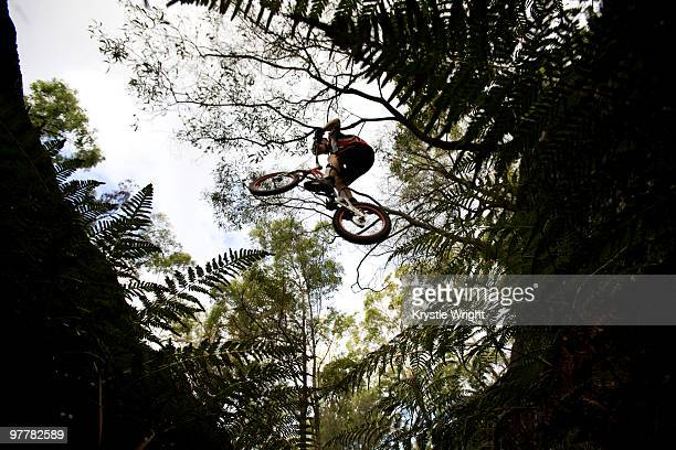 A Trials rider jumps a large gap at Toohey Forest, Brisbane, Queensland, Australia.