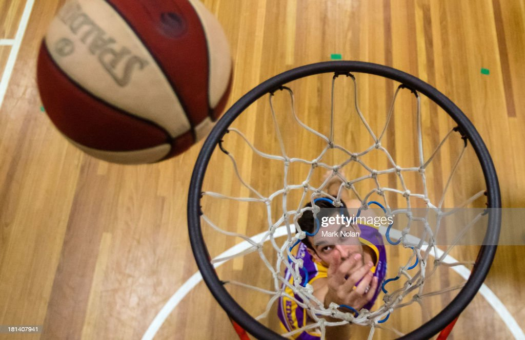 trian iliadis of the Kings lays up before the 2013/14 Pre-season Blitz match between the Sydney Kings and the New Zealand Breakers at the North Sydney Indoor Sports Centre on September 21, 2013 in Sydney, Australia.