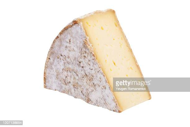 triangle cheese chunk isolated on white background - cheese stock pictures, royalty-free photos & images