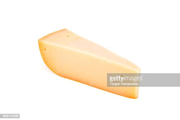 triangle cheese chunk isolated on white background - cheddar cheese stock photos and pictures