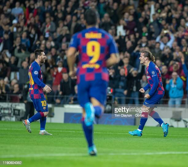 A triangle of goalscorer as Antoine Griezmann of Barcelona celebrates with Lionel Messi of Barcelona and Luis Suarez of Barcelona after scoring his...