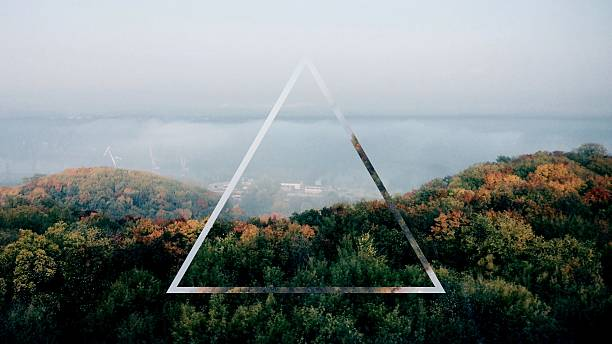 Triangle Shape Over Forest Against Cloudy Sky Wall Art