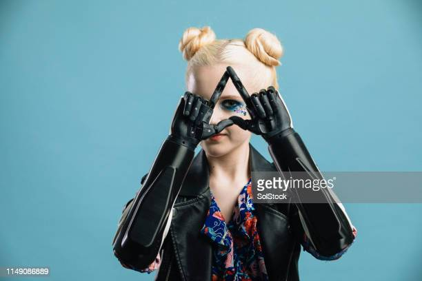 triangle sign with robotic arms - amputee girl stock pictures, royalty-free photos & images