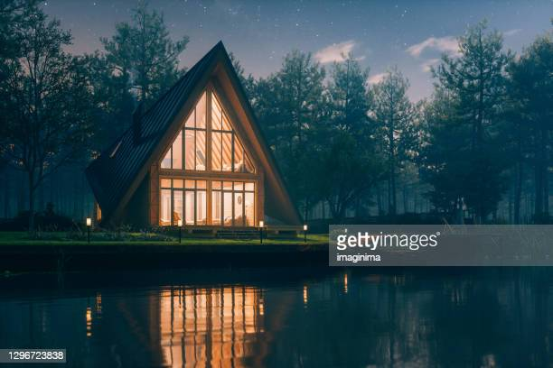 triangular modern lake house - house stock pictures, royalty-free photos & images