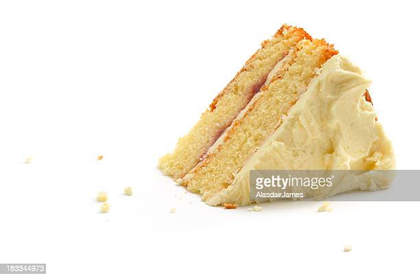 triangular piece of cake over white background - sponge cake stock pictures, royalty-free photos & images