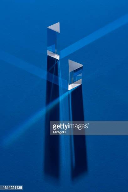 triangular prism refracting light beam - accuracy stock pictures, royalty-free photos & images