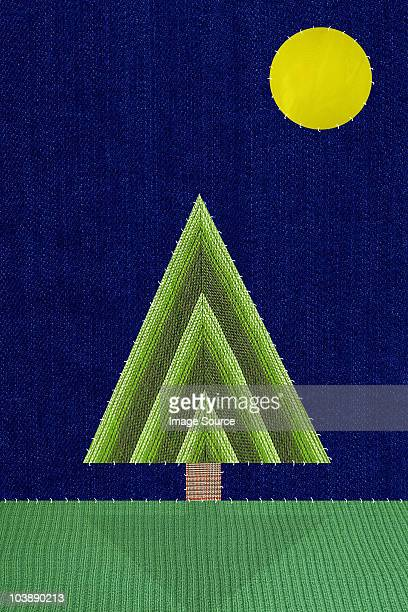 Triangular shaped tree and moon
