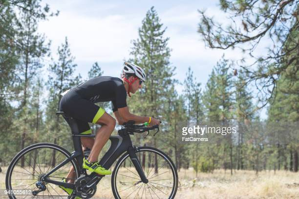 triathlete doing cycling stage - endurance stock pictures, royalty-free photos & images