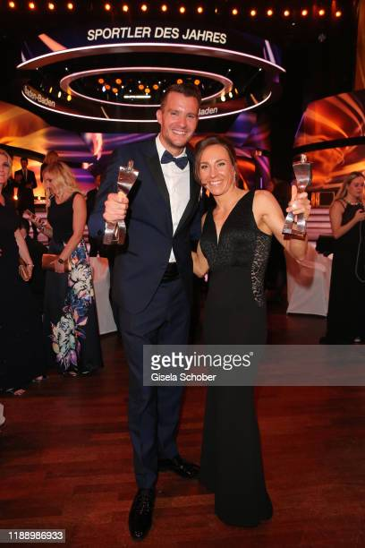 Triathlete, Iron Man 2019 Jan Frodeno and Triathletic Hawaii iron man winner Anne Haug with award during the 'Sportler des Jahres 2019' Gala at...