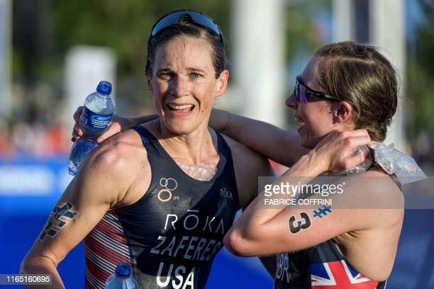 US triathlete Katie Zaferes celebrates her victory next to Britain's Georgia TaylorBrown after crossing the finish line to win her first world...