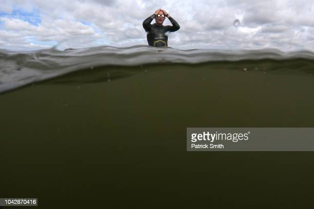 A triathlete prepares to swim as they train for the IRONMAN Maryland on September 28 2018 in Cambridge Maryland
