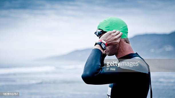 Triathlete preparing for an open water swim