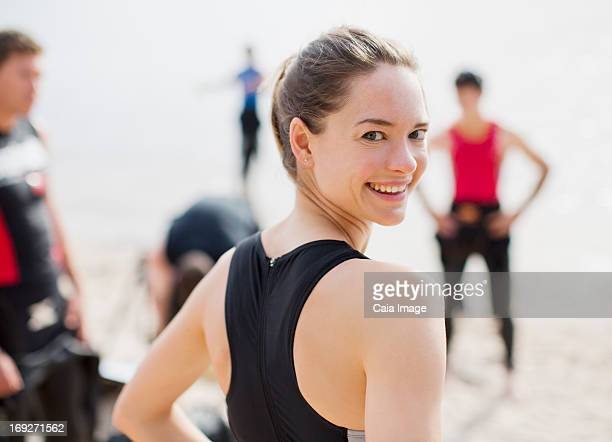 Triathlete smiling on beach