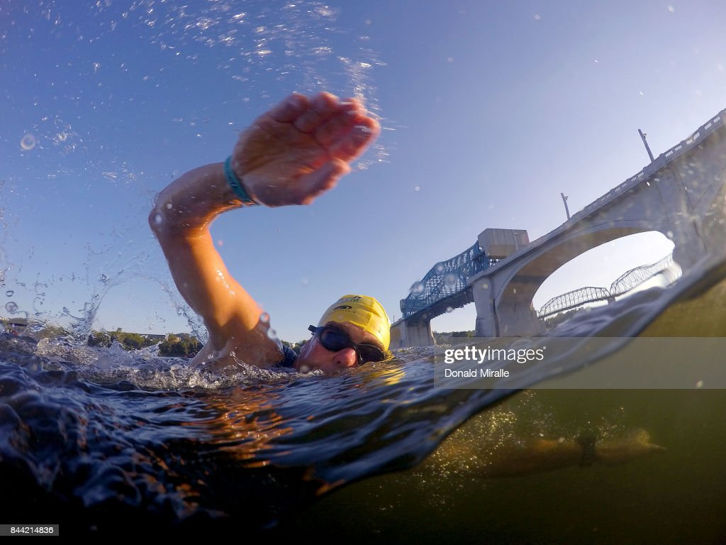 A triathlete swims in the Tennessee River under the John Ross Bridge during the warm-ups for the IRONMAN 70.3 St. World Championships on September 8, 2017 in Chattanooga, Tennessee.