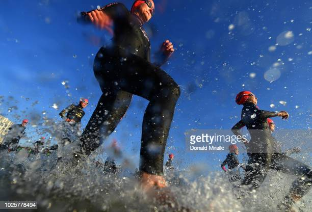 Triathletes enter the water for the swim leg during the Isuzu IRONMAN 703 World Championship Women in Port Elizabeth South Africa on September 1 2018...
