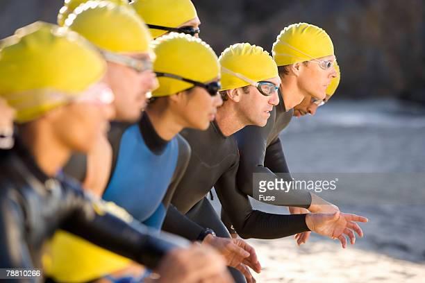 triathletes ready to race - concorso foto e immagini stock
